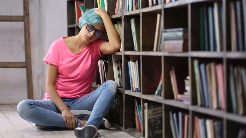 Depressed woman after failing exam in library | Shutterstock HD Video #32153011