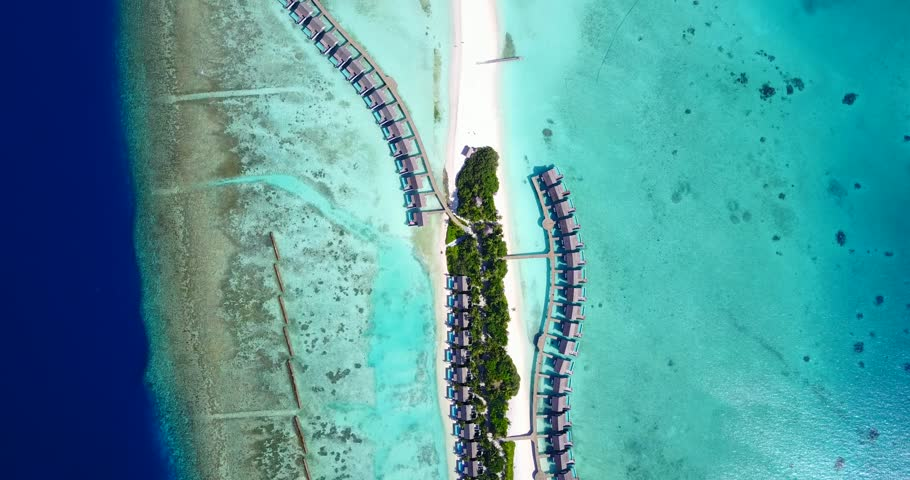 v09442 five 5 star resort water bungalows in Maldives with drone aerial flying view on white sand beach on tropical island