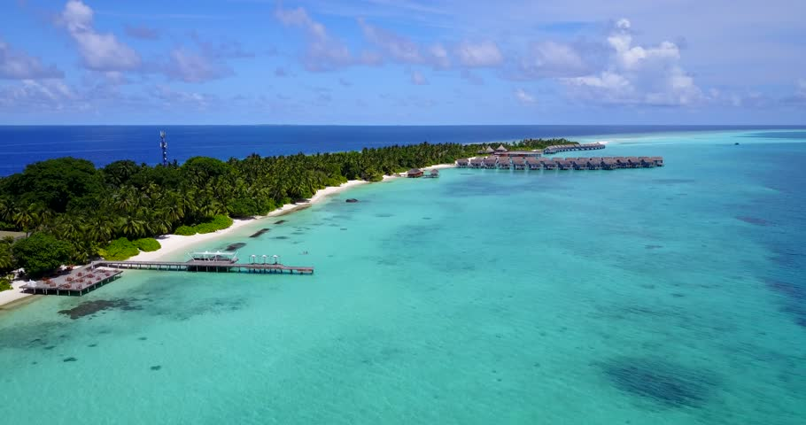 v09443 five 5 star resort water bungalows in Maldives with drone aerial flying view on white sand beach on tropical island