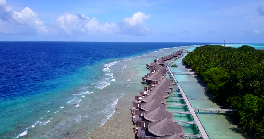 v09561 five 5 star resort water bungalows in Maldives with drone aerial flying view on white sand beach on tropical island