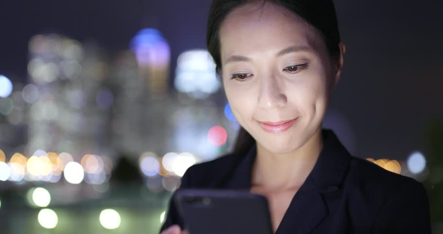 Business woman use of smart phone in city at night  | Shutterstock HD Video #32231731