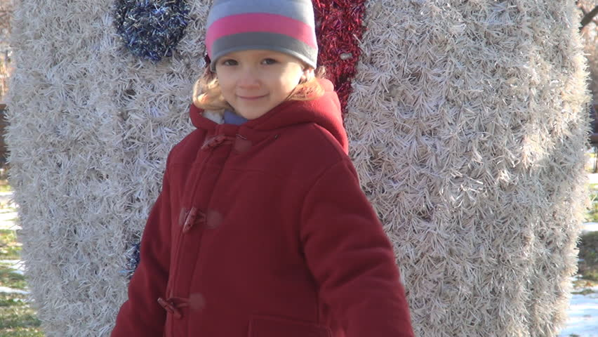 Child being Cold and Shivering in Park, Winter Season