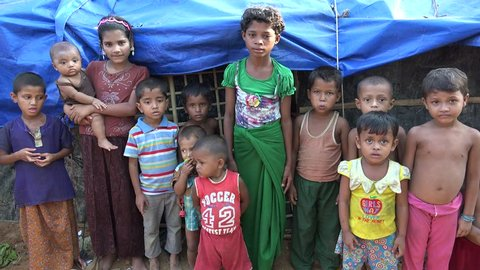 TEKNAF, BANGLADESH - OCTOBER 25, 2017: A group of helpless Rohingya refugee children are staring with big hapless eyes in the camera