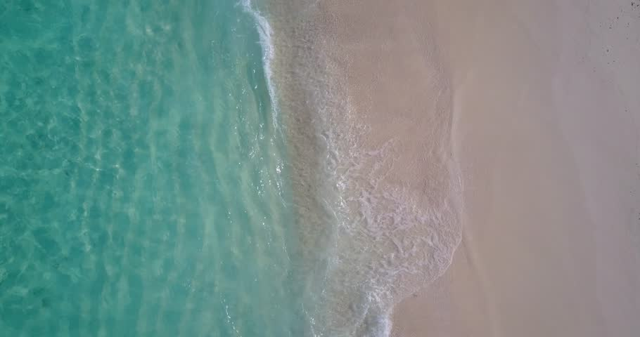 Waves water texture breaking and crashing with drone aerial flying view of aqua blue and green clear sea ocean | Shutterstock HD Video #32261641