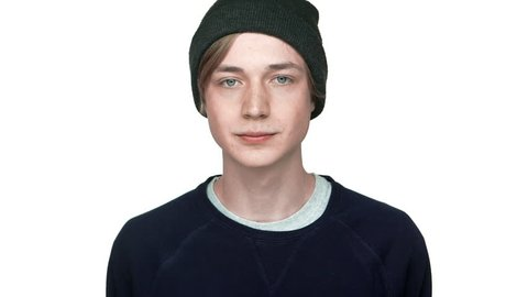 slow motion portrait of blue-eyed teen guy in csual clothes tired of someone feeling boredom hinting at something with eyes isolated over white background closeup. Concept of emotions