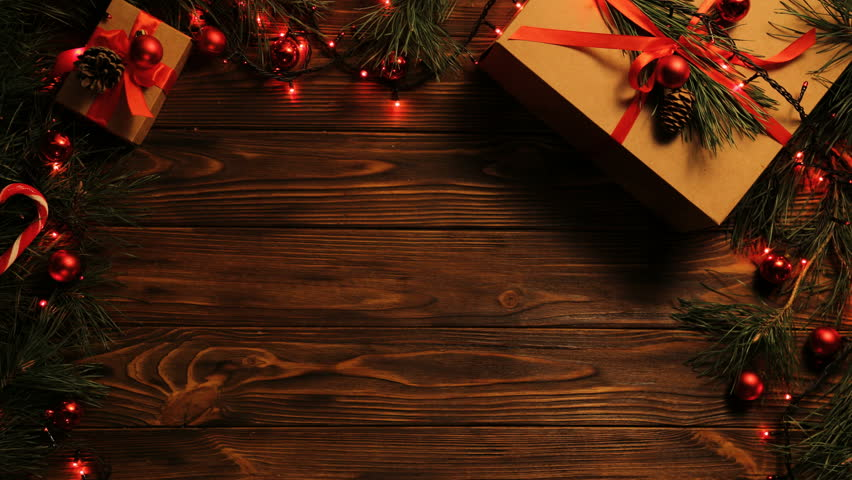 Top view. Wooden brown table decorated with Christmas stuff and garlands. Red Christmas lights. Close up. | Shutterstock HD Video #32290441