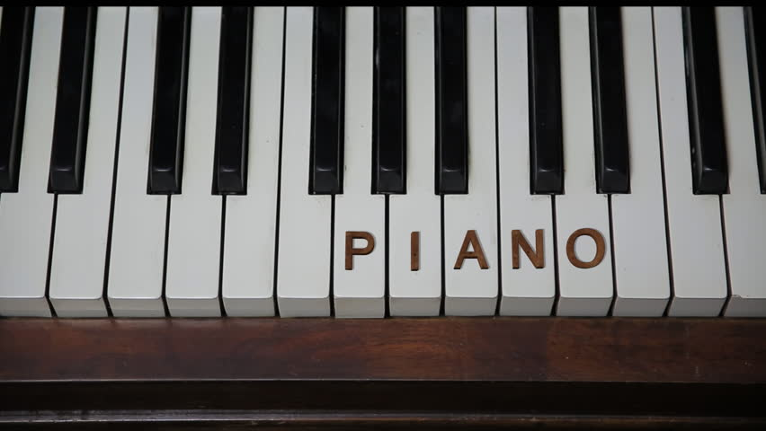 PIANO Redwood Letters White Keys Stock Footage Video