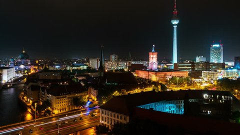 Berlin, Germany. Aerial view of illuminated landmarks in Berlin, Germany at night. Time-lapse of car trails, dark sky