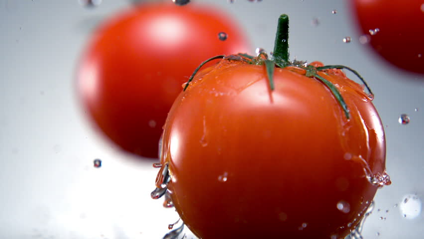 Water splash on tomato shooting with high speed camera, phantom flex. | Shutterstock HD Video #3230119
