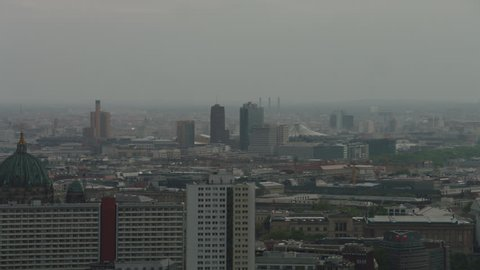 May, 2017 Berlin, Germany. Aerial zoom out on the Potsdamer Platz, reveal, Berlin Skyline with the Berliner Dome and Saint Mary\xD5s Church.