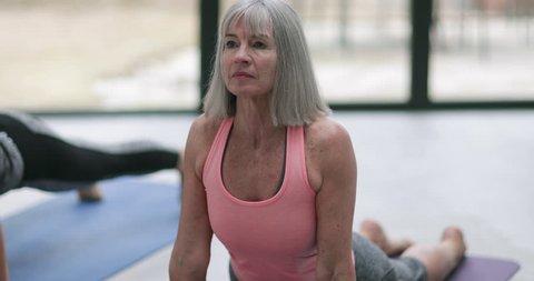 Senior Woman in a yoga class