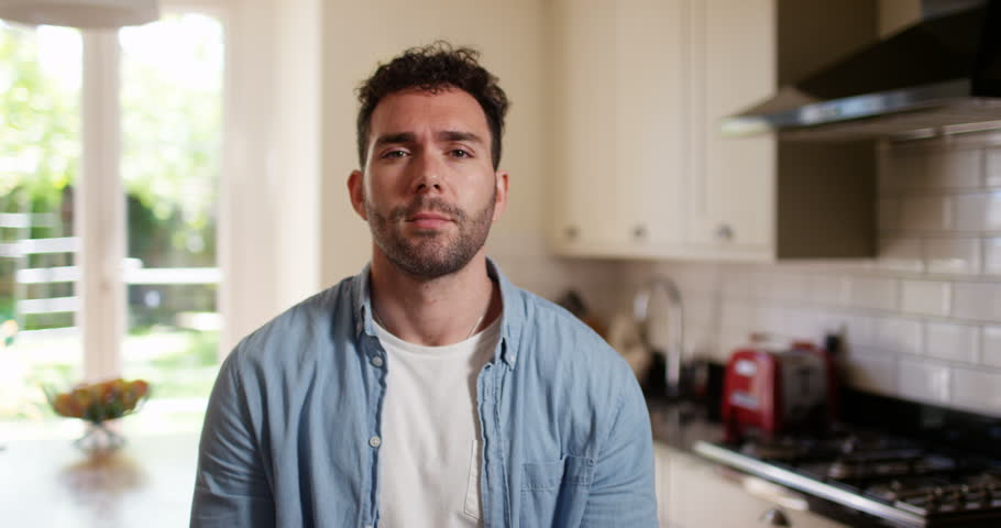 4K Casual man in the kitchen at home engaged in very boring video call | Shutterstock HD Video #32309257