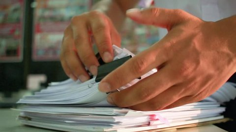 Businessman searching documents files or information in Stack of papers folder on work in office, Business report paper or piles of unfinished document achieves with clips on offices, Business concept