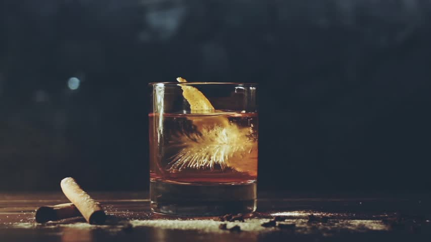 Alcohol cocktail with ice cubes on bar