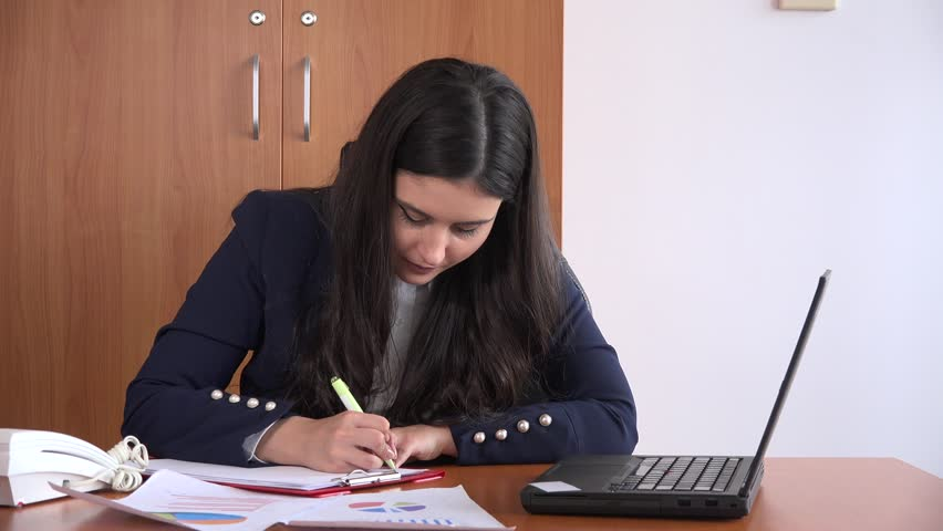 Busy workaholic attractive businesswoman inside office reading charts writing 4K