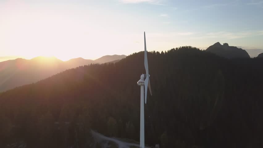 Aerial view of Wind Turbine during a vibrant and colorful summer sunset. Taken on top of Grouse Mountain in Northshore Vancouver, British Columbia, Canada.   Shutterstock HD Video #32317981