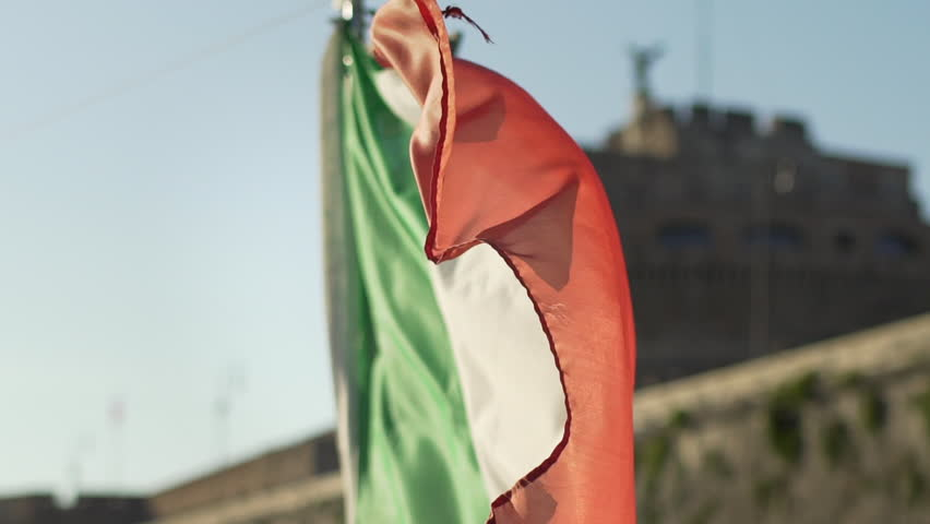 Stunning slow motion of Italian flag waving ahead Castel Sant'Angelo castel in Rome, Italy, during sailing on the river Tiber. Italian symbols in European and Italian holidays.