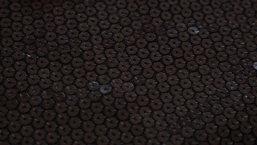 fabric as background. 4k, slow movement, black knitted fabric with paillettes.