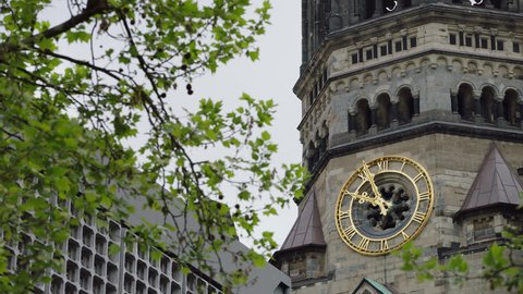 May, 2017 Berlin, Germany. Kaiser Wilhelm Memorial Church upward angle close up of bell tower clock during the day.
