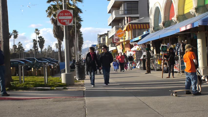 VENICE BEACH, CALIFORNIA - CIRCA 2011:  Tourists and locals walk on the boardwalk at Venice Beach, CA .