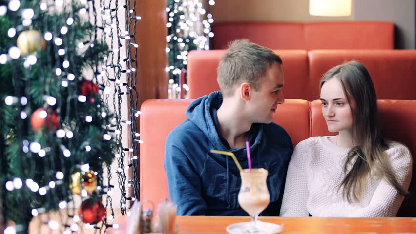 Young couple chatting sitting in cafe in Christmas time   Shutterstock HD Video #32354281