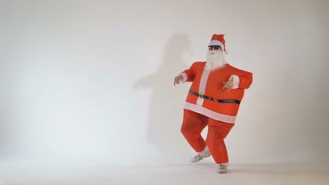 Junior funny thin Santa Claus dancing and having fun.