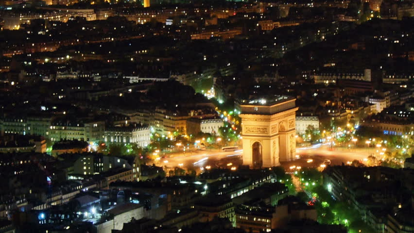 Etoile , where the Arc de Triomphe is located seen from Eiffel Tower, time-lapse night