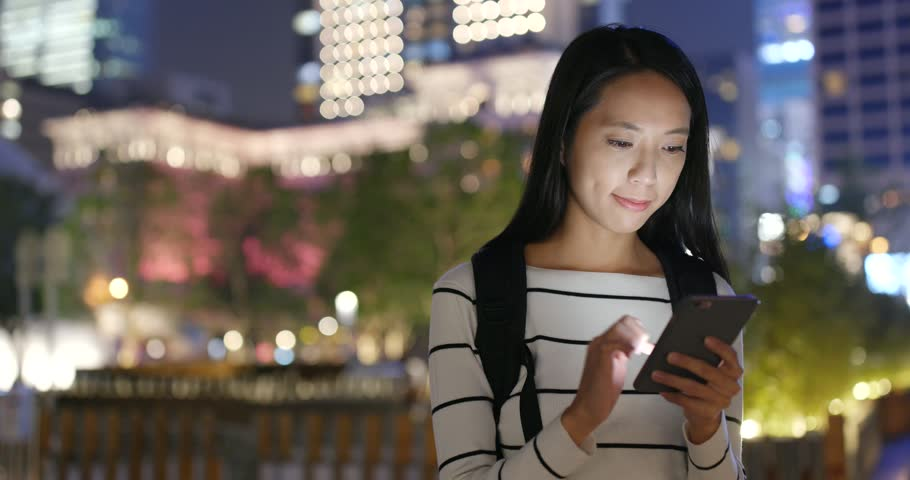 Woman use mobile phone in Hong Kong at night  | Shutterstock HD Video #32432521