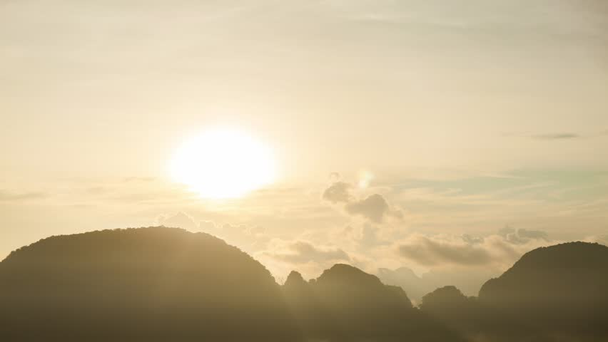 beautiful sunlight in the morning sunrise above flowing fog waves on mountain tropical rainforest in phang nga thailand #32435581