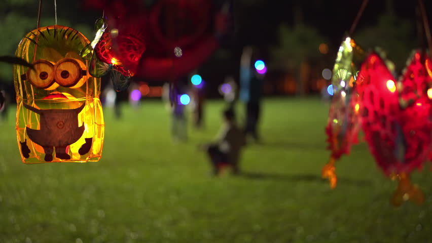 Malaysia Traditional Minions Shape Chinese Lantern Hanging On A Tree During Mid-Autumn Festival With Blurry Background
