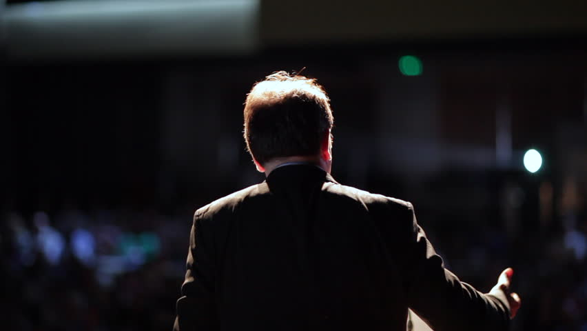 Speaker performing a lecture in front of an audience. Person giving a speech to crowd of people | Shutterstock HD Video #32462179