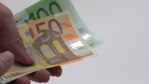Slow motion of hands counting euros bills of fifty and one hundred. To count money income. Economic success country. Successful business. Issuing salary. Bank percent deposit. Credit percent. Euro-Dan