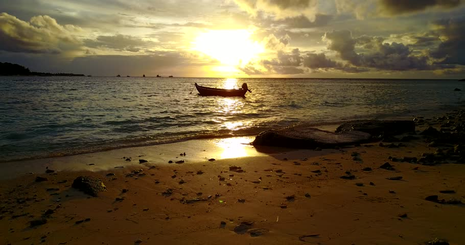 V14947 silhouette sailing boat at sunset sunrise with beautiful sky and sea on island beach | Shutterstock HD Video #32495851