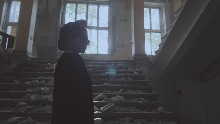 Girl in a hat walks in a ruined building | Shutterstock HD Video #32501791
