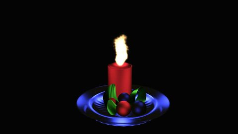 burning red advent candle on blue glass plate