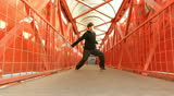 A street dancer performer person dance on a bridge