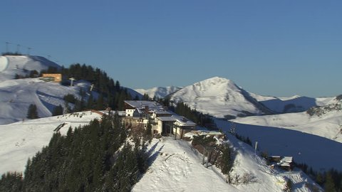 WS AERIAL ZO Snowy mountains with ski resort / Wilder Kaiser, Kitzbuhel Alps, Tyrol, Austria