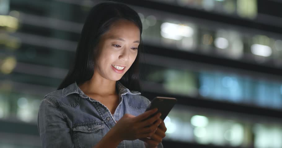 Woman using mobile phone in city at night | Shutterstock HD Video #32570941