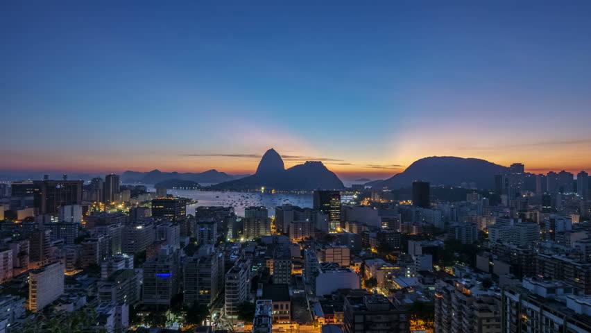 View over Botafogo towards the Sugarloaf Mountain, Night to Day Timelapse, Rio de Janeiro, Brazil