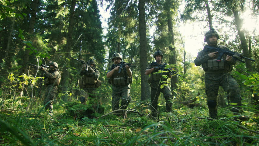 Squad of Five Fully Equipped Soldiers in Camouflage on a Reconnaissance Military Mission, Rifles Ready. They're Moving in Formation Through Dense Forest. Low Angle Footage. 4K UHD. | Shutterstock HD Video #32587891