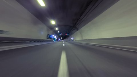 Circulating quickly through a tunnel without traffic and at the end  you come to the exit with fade in white. Time Lapse - Vehicle shot - Point of view,Tunnel Dos Valires -  ANDORRA
