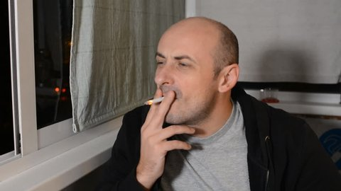 Man Smokes Cigarette