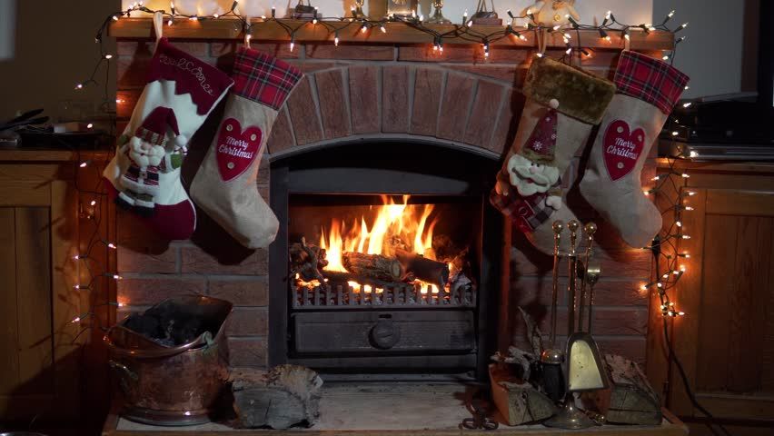 Christmas fireplace stockings hanging with presents cozy for Stocking clips for fireplace