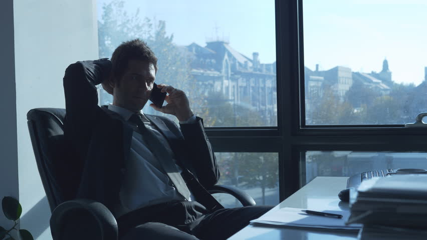 Successful businessman working in the modern office and talking on the mobile phone | Shutterstock HD Video #32636671