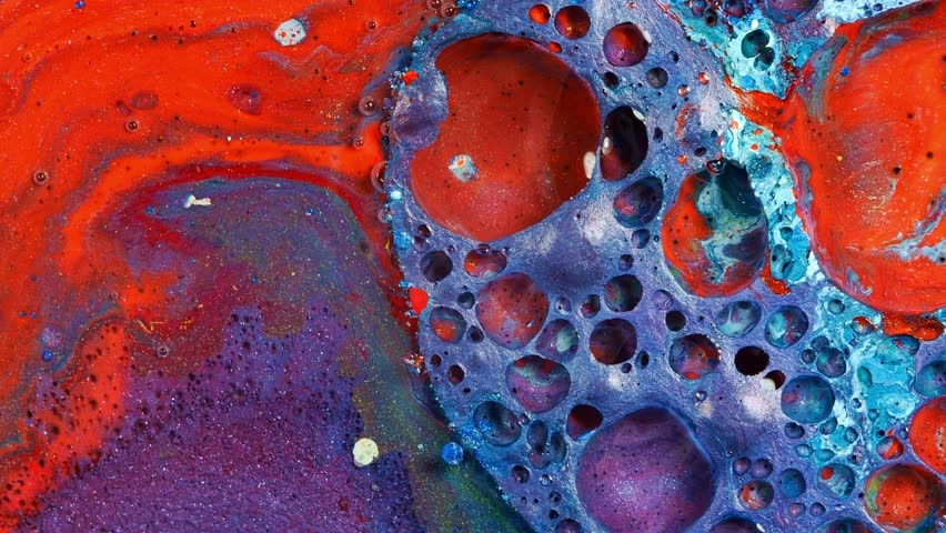 Complex purple and red and blue vibrant bright paint and oil color swirls entropy