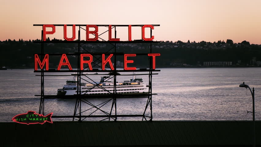 SEATTLE - CIRCA 2012: A ferry passes behind the Public Market sign in Seattle in 2011.