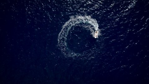 View from the height of a motor boat designing a circle in the sea navigating fast