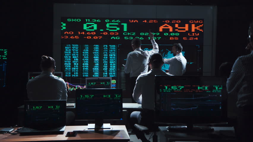 Two stock broker team leaders in front of a live, futuristic global market feed. | Shutterstock HD Video #32687305