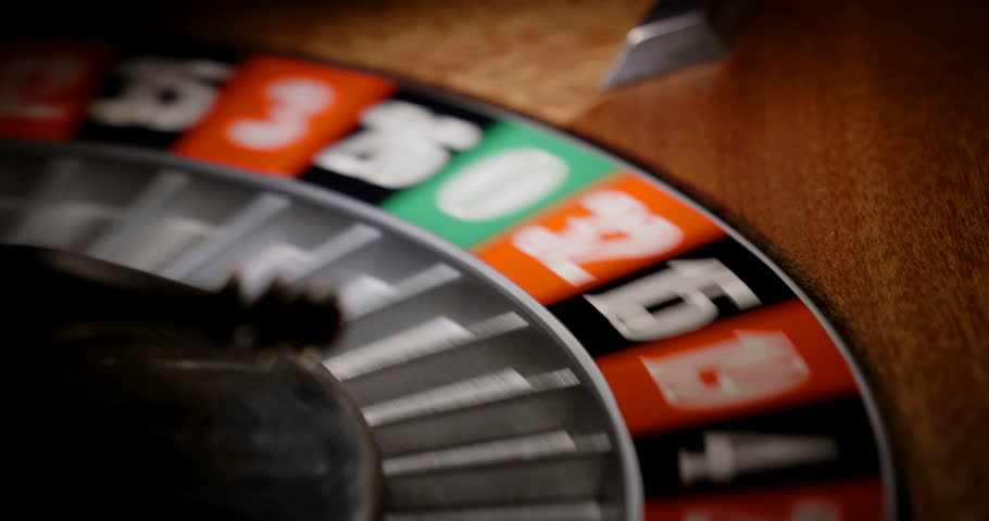 Macro shot of a roulette in a casino where the ball goes to the green or red or black number. People having bet and bet money may have won lost badges. Concept of: fate, gambling, luck, destiny. | Shutterstock HD Video #32706577
