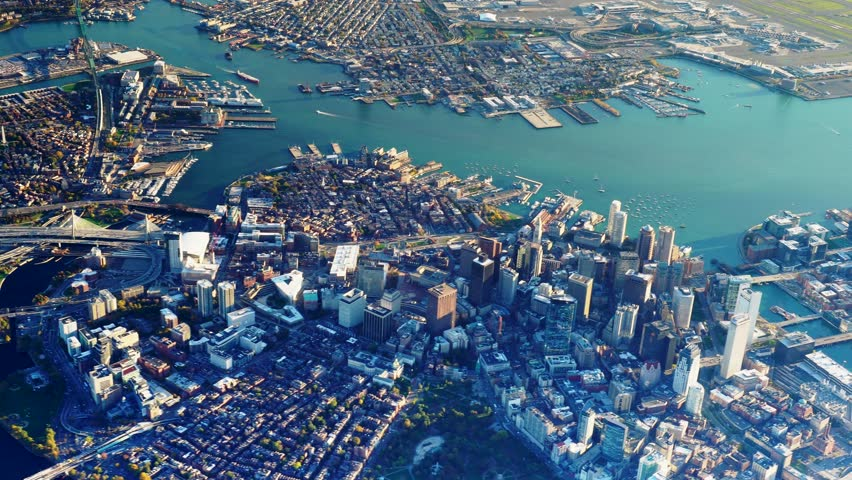 Boston, MA - CIRCA 2017 - Daytime high AERIAL view of downtown Boston, North Shore, Cambridge, & Logan